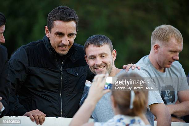 Former Manchester United player and now joint owners of Salford City, Gary Neville has a picture taken with a fan during the Vanarama Conference...