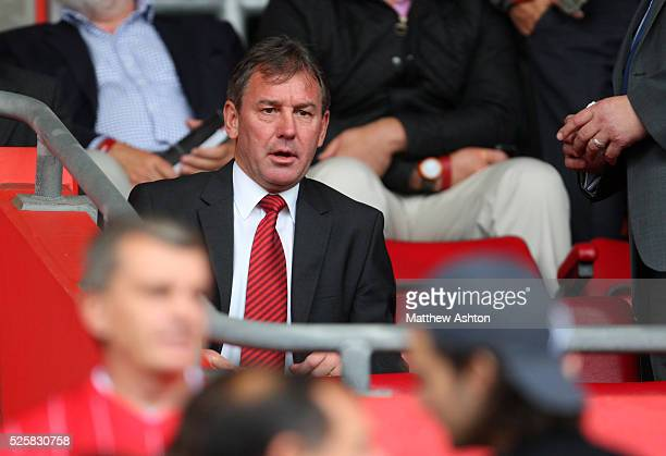 Former Manchester United player Bryan Robson takes his seat in the stands as Sir Alex Ferguson the head coach / manager of Manchester United takes...