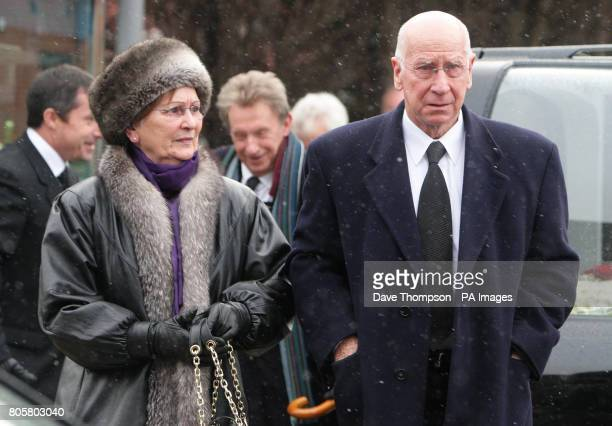Former Manchester United player Sir Bobby Charlton and his wife Lady Norma arrive for the funeral of Busby Babe Albert Scanlon at All Souls Church in...