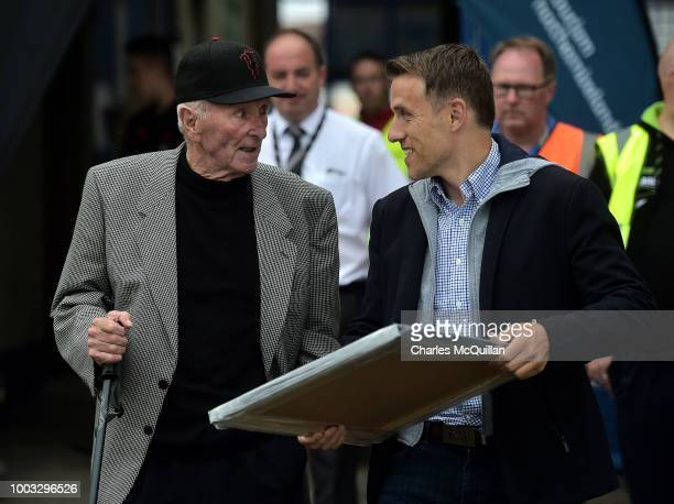 Former Manchester United players Phil Neville and Harry Gregg chat before the u19 NI Super Cup gala match between Manchester United and Celtic at...