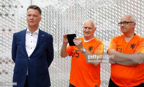 Former Manchester United's head coach Louis van Gaal , flanked by two football fans attends the unveiling of the Oranje Wall of Fame at the KNVB...
