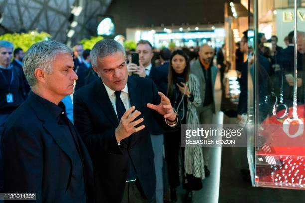 Former Manchester United's Portuguese coach Jose Mourinho listens to Hublot watchmaker CEO Ricardo Guadalupe at the Baselworld watch and jewellery...