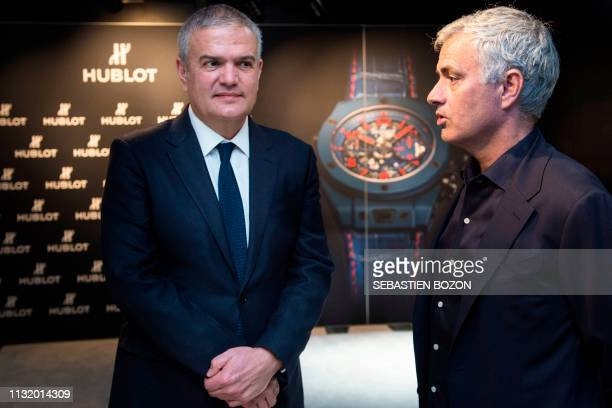 Former Manchester United's Portuguese coach Jose Mourinho speaks with Hublot watchmaker CEO Ricardo Guadalupe at the Baselworld watch and jewellery...