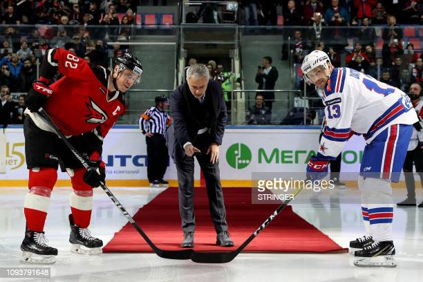 Former Manchester United's Portuguese manager Jose Mourinho drops the puck to start a Continental hockey league match between Avangard Omsk and SKA...