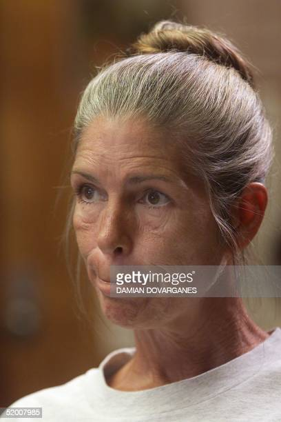 Former Manson family member Leslie Van Houten reacts as members of a California prison board declare her parole dennied 28 June at the California...
