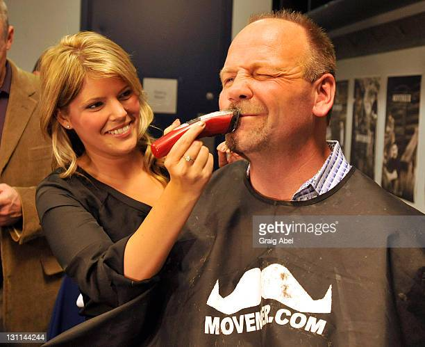 Former Maple Leafs captain Wendel Clark has his moustache shaved in preperaton of Movember during a break in NHL game action between the Toronto...
