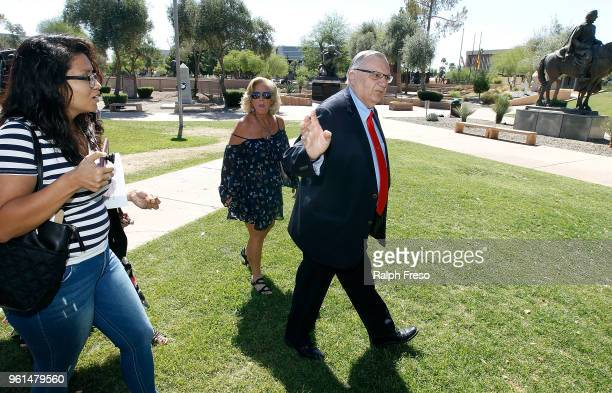 Former Maricopa County Sheriff Joe Arpaio avoids a question from a member of the community regarding his policy on immigration as he prepares to...