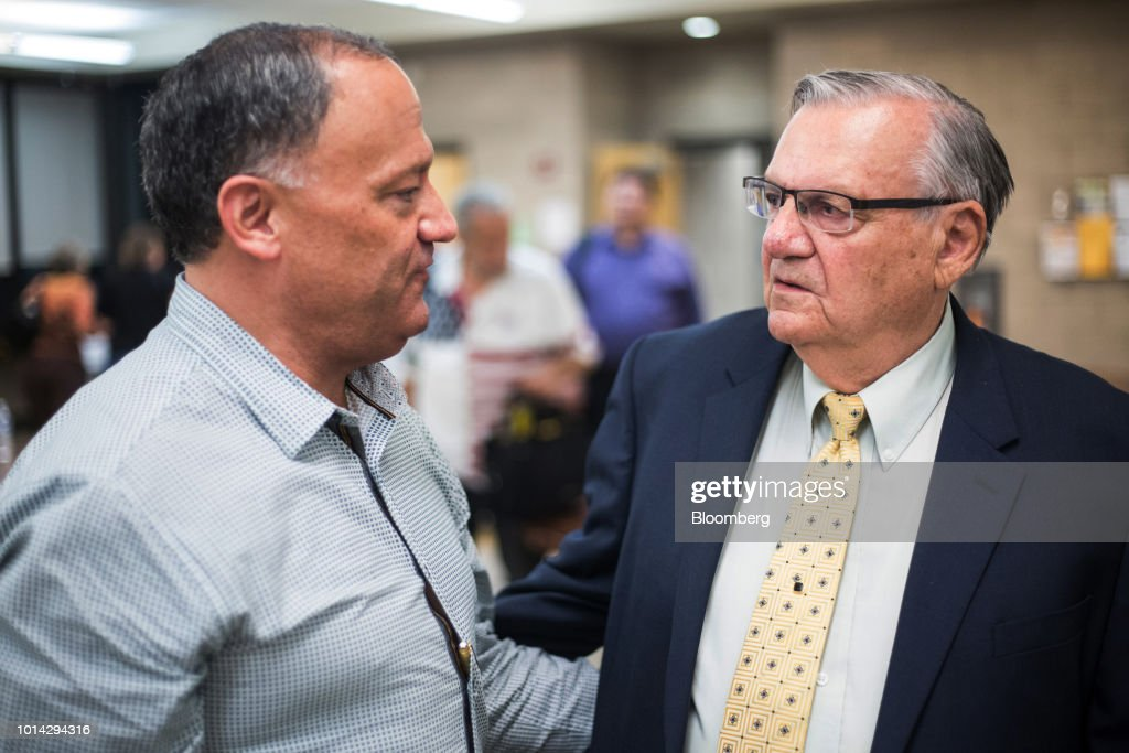 Former Maricopa County Sheriff Joe Arpaio, Republican U.S Senate candidate, right, speaks with community organizer John Rodriguez during a town hall meeting in Phoenix, Arizona, U.S., on Thursday, Aug. 9, 2018. Last year, U.S. President Donald Trump pardoned Arpaio who had been convicted of federal misdemeanor criminal contempt for defying a court order to stop traffic patrols targeting immigrants. Photographer: Conor Ralph/Bloomberg via Getty Images