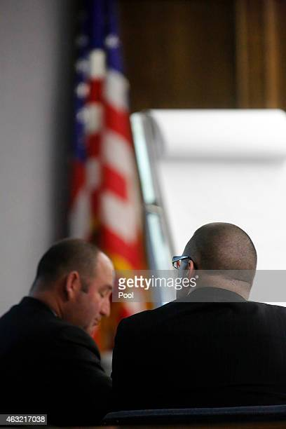 Former Marine Cpl Eddie Ray Routh views crime scene photos displayed by the prosecution during the capital murder trial of former Marine Cpl Eddie...