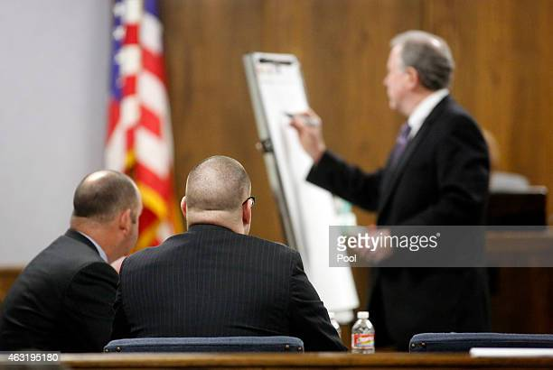 Former Marine Cpl Eddie Ray Routh watches as his court appointed attorney Tim Moore writes out a timeline during opening statements of his capital...