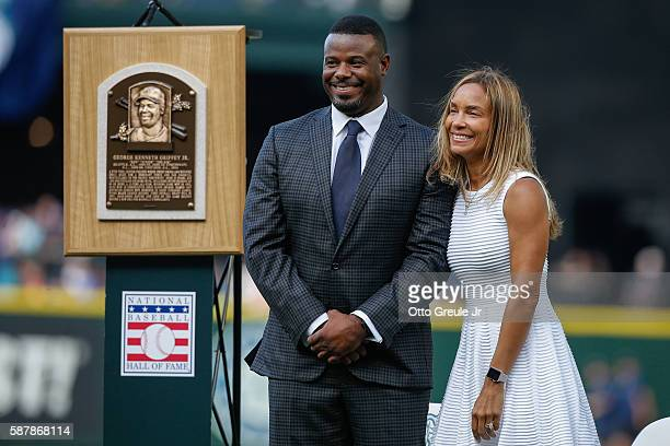 Former Mariner Ken Griffey Jr and his wife Melissa look on during a jersey retirement ceremony prior to the game between the Seattle Mariners and the...