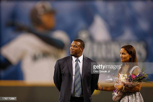 Former Mariners great Ken Griffey Jr and wife Melissa look on during a ceremony inducting him into the Seattle Mariners Hall of Fame prior to the...