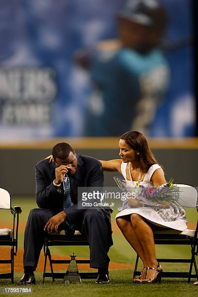 Former Mariners great Ken Griffey Jr is comforted by his wife Melissa during a ceremony inducting him into the Seattle Mariners Hall of Fame prior to...