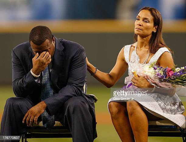 Former Mariners great Ken Griffey Jr is comforted by his wife Melissa after he teared up following a video greeting from his son Trey during a...