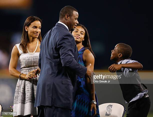 Former Mariners great Ken Griffey Jr is greeted by members of his family including wife Melissa daughter Taryn and son Tevin during a ceremony...
