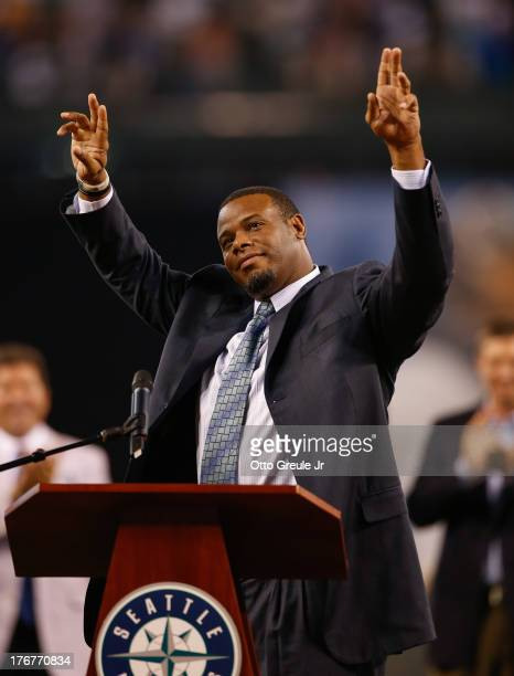 Former Mariners great Ken Griffey Jr waves to the crowd as he is introduced during a ceremony inducting him into the Seattle Mariners Hall of Fame...