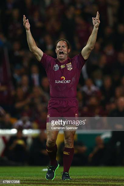 Former Maroons captain Billy Moore inspires the crowd prior to game three of the State of Origin series between the Queensland Maroons and the New...