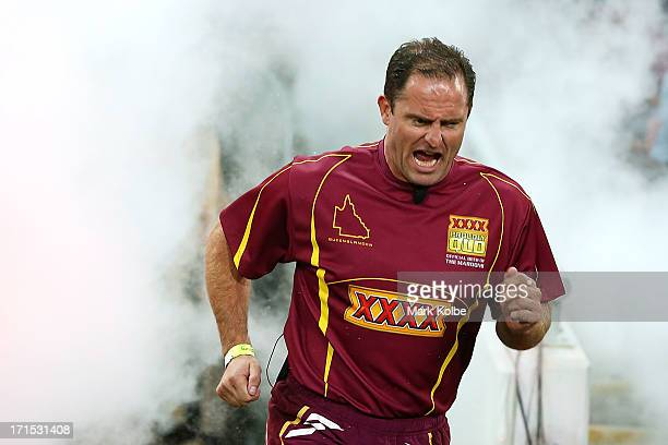 Former Maroons player Billy Moore runs onto the field before game two of the ARL State of Origin series between the Queensland Maroons and the New...