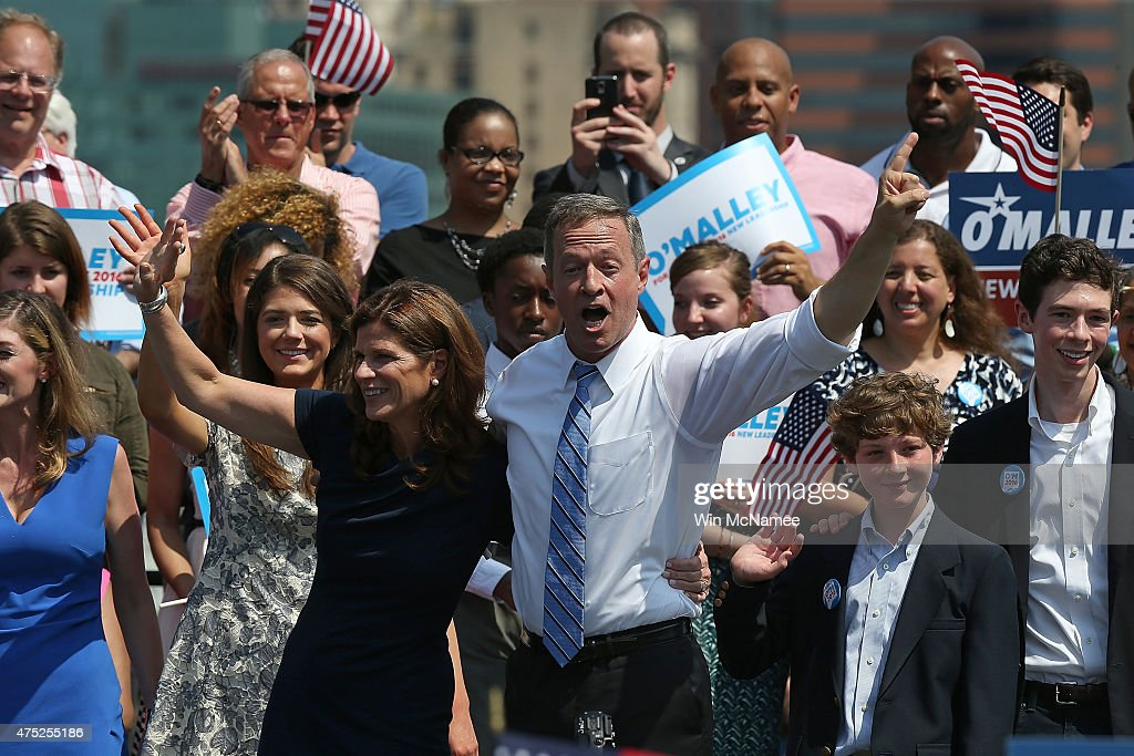 Former Maryland Gov. Martin O'Malley celebrates with his wife Katie and their family after O'Malley officially announced his candidacy for the U.S. presidency during an event at Federal Hill Park May 30, 2015 in Baltimore Maryland. O'Malley joins Sen. Bernie Sanders and former Secretary of State Hillary Clinton in seeking the Democratic nomination.