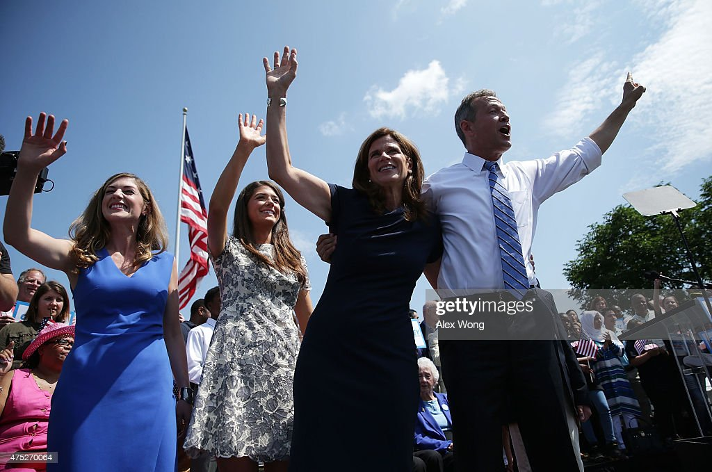 Former Maryland Gov. Martin O'Malley (R), his wife Katie (2nd R) and his family wave to the crowd during an event to announce his candidacy for a presidential campaign May 30, 2015 at Federal Hill Park in Baltimore, Maryland. O'Malley was the third Democrat, after former U.S. Secretary of State Hillary Clinton and Sen. Bernie Sanders (I-VT), to throw his hat in the ring for the Democratic nomination.