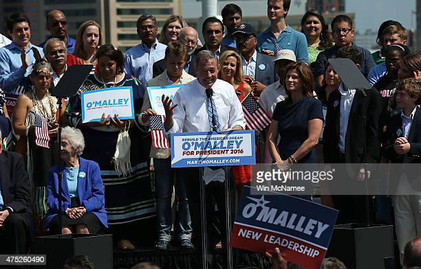 Former Maryland Gov Martin O'Malley officially announces his candidacy for the US presidency with his wife Katie during an event at Federal Hill Park...