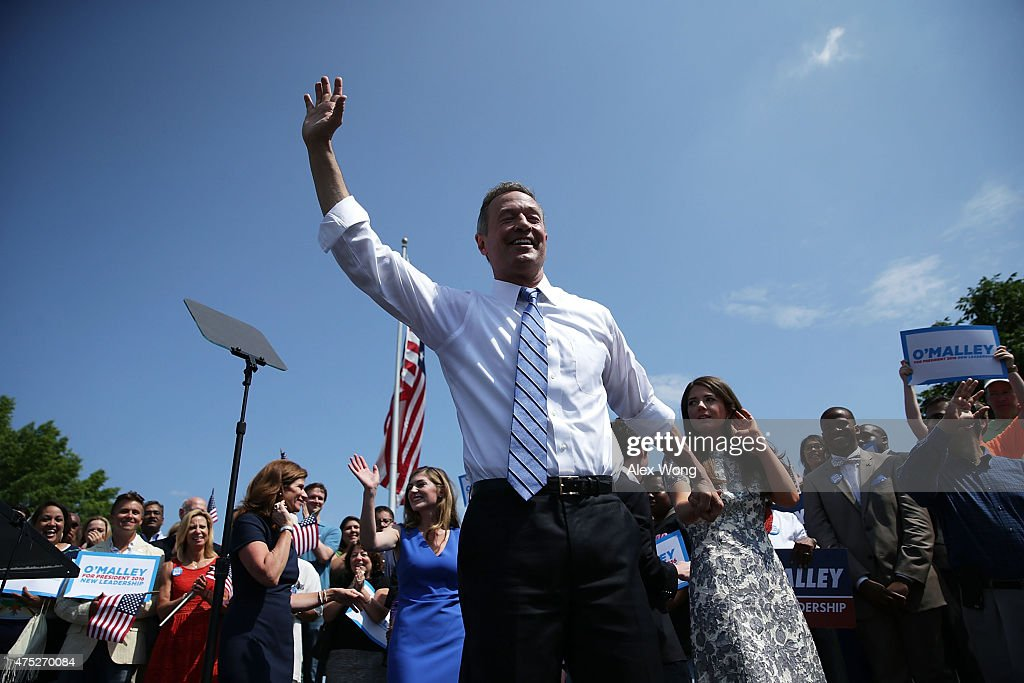 Former Maryland Gov. Martin O'Malley (C) waves to the crowd with his family during an event to announce his candidacy for a presidential campaign May 30, 2015 at Federal Hill Park in Baltimore, Maryland. O'Malley was the third Democrat, after former U.S. Secretary of State Hillary Clinton and Sen. Bernie Sanders (I-VT), to throw his hat in the ring for the Democratic nomination.