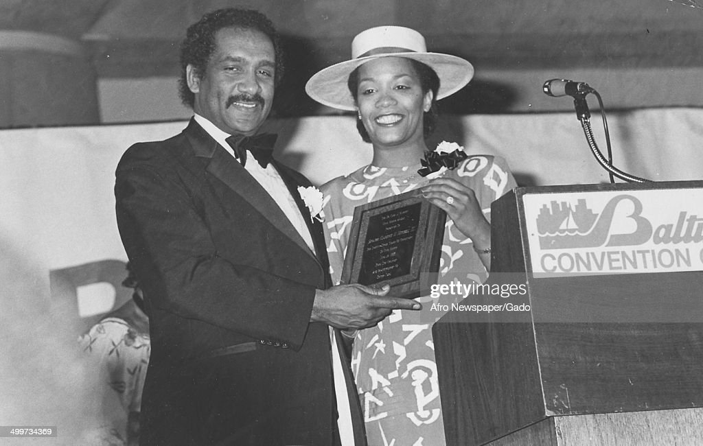 Former Maryland State Senator Clarence Mitchell III (1939 - 2012) and Afro American Newspapers employee Bonnie Butler holding the Carl Murphy award at Baltimore Convention Center, Baltimore, Maryland, 1974.