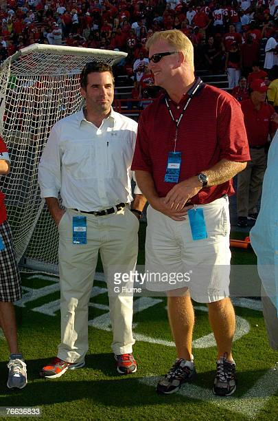 Former Maryland Terrapins Boomer Esiason and Kevin Plank talk on the sidelines before the game between the Maryland Terrapins and the Villanova...