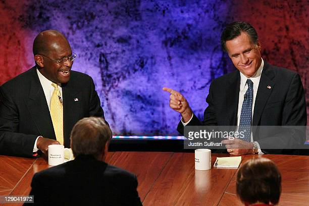 Former Massachusetts Gov Mitt Romney and former CEO of Godfather's Pizza Herman Cain participate in the Republican Presidential debate hosted by...