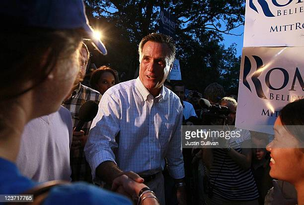 Former Massachusetts governor and republican candidate for president Mitt Romney greets supporters during a Tea Party rally on September 4 2011 in...