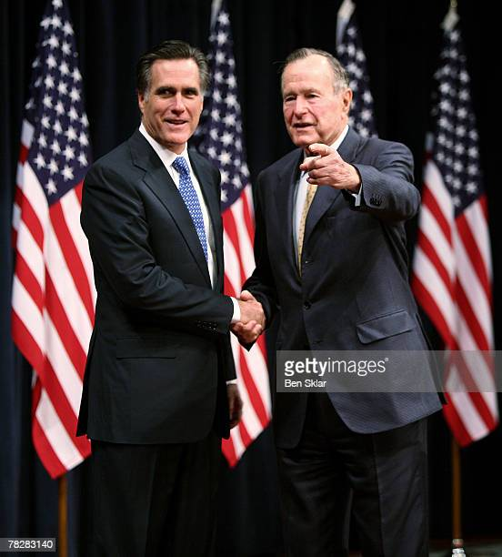 Former Massachusetts Governor and Republican President hopeful Mitt Romney shakes hands with former US President George Bush before speaking on faith...