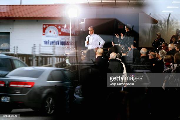 Former Massachusetts governor and Republican presidential candidate Mitt Romney is seen through the glass doors of the Mississippi Valley Fairgrounds...