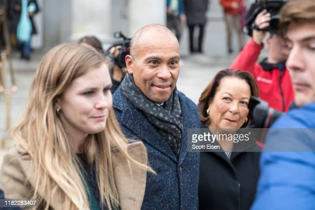 Former Massachusetts Governor Deval Patrick and his wife Diana leave the New Hampshire State House after he filed his paperwork to run for president...