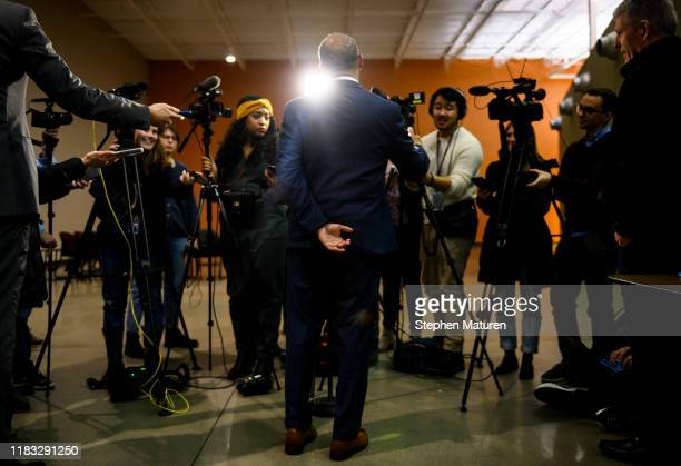 Former Massachusetts Governor Deval Patrick speaks with members of the media after attending a meeting of the Polk County Democrats on November 18,...