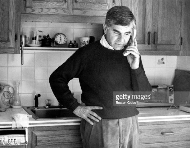 Former Massachusetts Governor Michael Dukakis talks on the phone in the kitchen of his Brookline MA home on Apr 29 1992