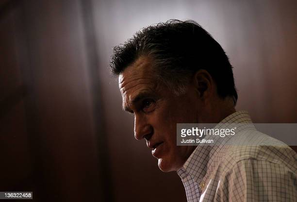 Former Massachusetts governor Mitt Romney speaks during a campaign stop on January 1 2012 in Council Bluffs Iowa With two days before the Iowa...
