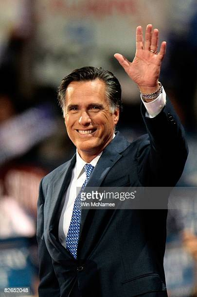 Former Massachusetts Republican Gov Mitt Romney waves to the crowd on day three of the Republican National Convention at the Xcel Energy Center on...
