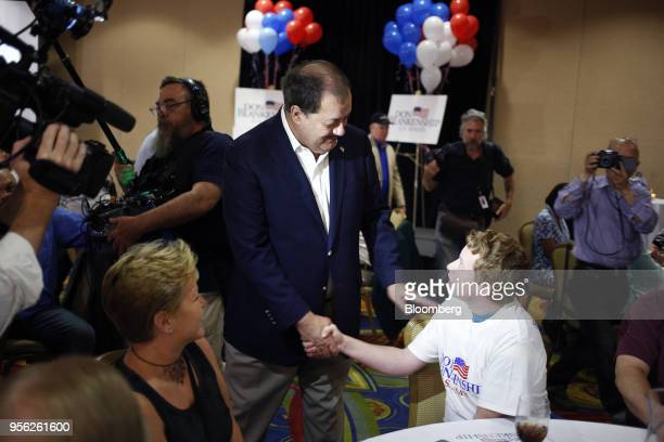 Former Massey Energy CEO Don Blankenship Republican US Senate candidate from West Virginia center greets an attendee during an election night event...