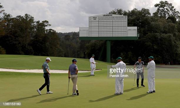 Former Masters Champions Zach Johnson of the United States, Danny Willett of England and Jordan Spieth of the United States look on with their...