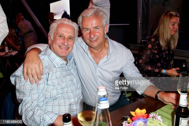 Former mayor of Berlin Klaus Wowereit and his husband Joern Kubicki during the 175th anniversary of Berlin Zoological Garden on August 9, 2019 in...