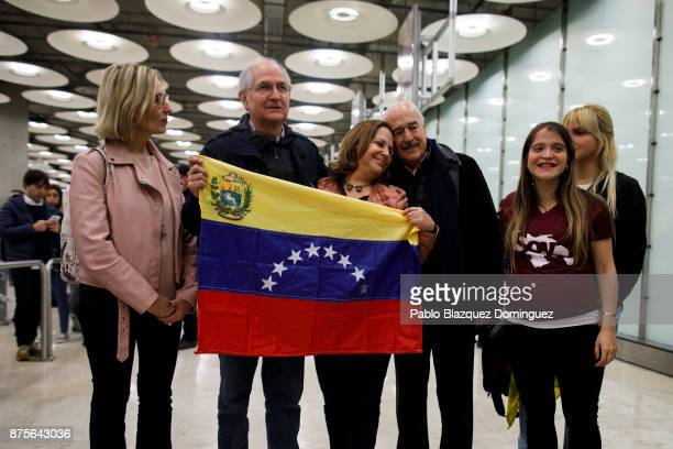 Former mayor of Caracas Antonio Ledezma holds the Venezuelan flag as he poses for the press with his wife Mitzy Capriles and family at his arrival to...