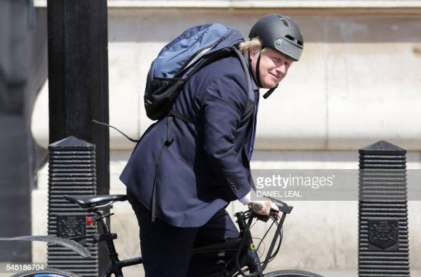 Former Mayor of London and proBrexit supporter Boris Johnson rides his bicycle through Westminster in central London on July 6 2016