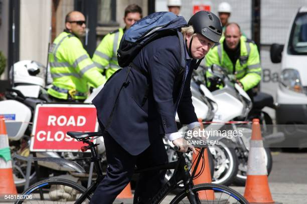 Former Mayor of London and proBrexit supporter Boris Johnson rides his bicycle through Westminster in central London on July 6 2016 / AFP / Daniel...