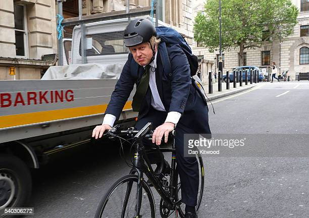 Former Mayor of London Boris Johnson cycles past Portcullis House on June 15 2016 in London England Johnson is part of the campaign for the United...