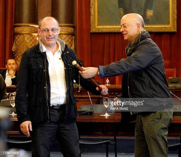 Former mayor of San Sebastian socialist Odon Elorza gives the makila to the new mayor Juan Carlos Izagirre member of proindependence Basque coalition...