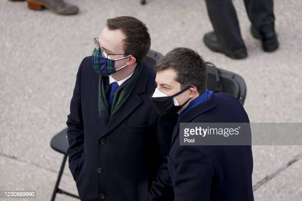 Former mayor of South Bend Pete Buttigieg arrives with his husband Chasten Buttigieg to the West Front of the U.S. Capitol during the 59th...