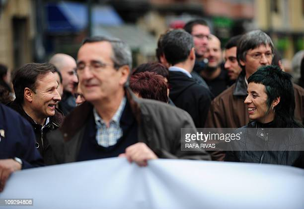 Former mayor of the Basque village of Getxo and Basque Nationalist party representative Inaki Zarraoa holds a banner followed by the Basque patriotic...