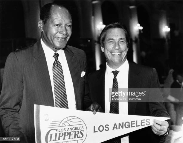 Former LA Mayor Tom Bradley and Donald Sterling of the Los Angeles Clippers poses for a photograph during a game circa 1987 at the Los Angeles...