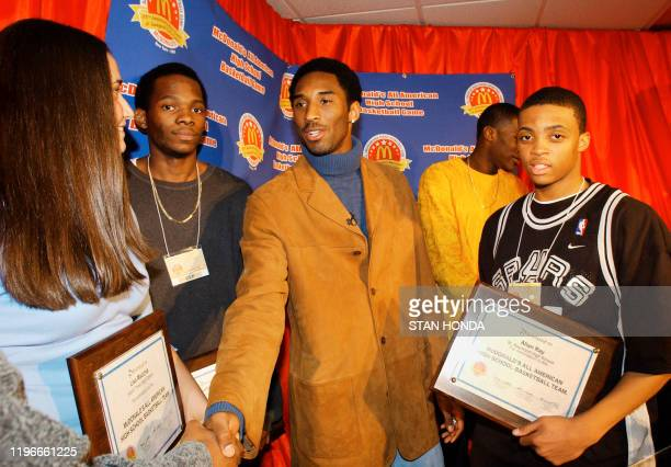 Former McDonald's All American and Los Angeles Lakers star Kobe Bryant congratulates New York area McDonald's All American High School Basketball top...