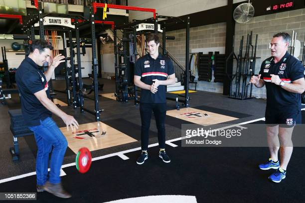 Former Melbourne Storm player Billy Slater kicks the ball to Saints head coach Alan Richardson and Jack Steele of the Saints during a St Kilda Saints...